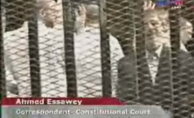 Morsi being transferred after trial