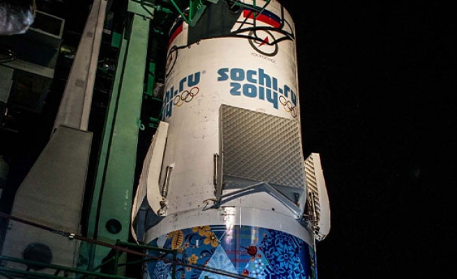 Russian Soyuz rocket flies Olympic torch to space station