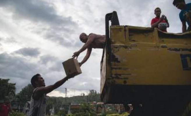 Typhoon survivors desperate for food, water and medicine