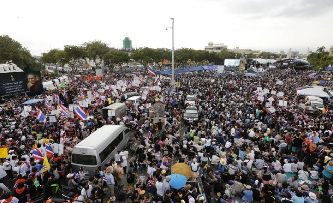 Thai vote goes smoothly, protesters regroup near Bangkok