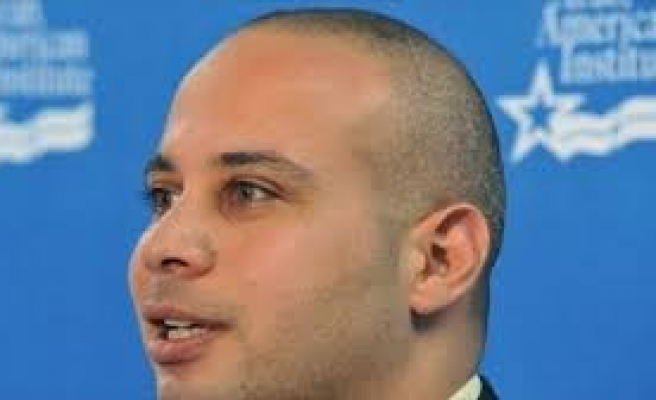 Egyptian activist gives himself up to prosecutors