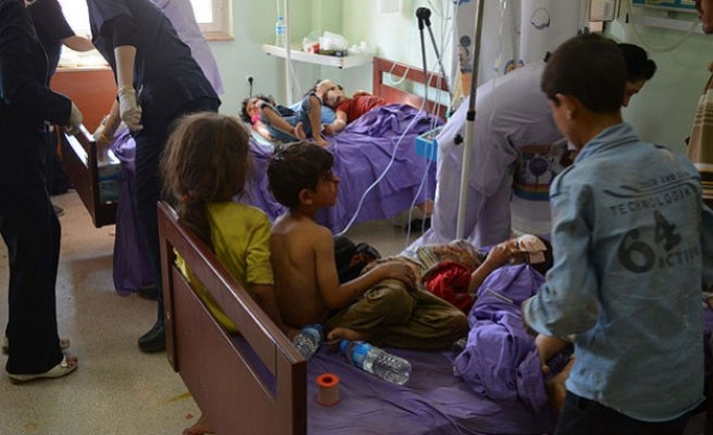 Syrian opposition accuses Assad's forces of new poison gas attack