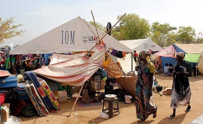 In rebel-held town, S. Sudan's Nuer trade services for safety