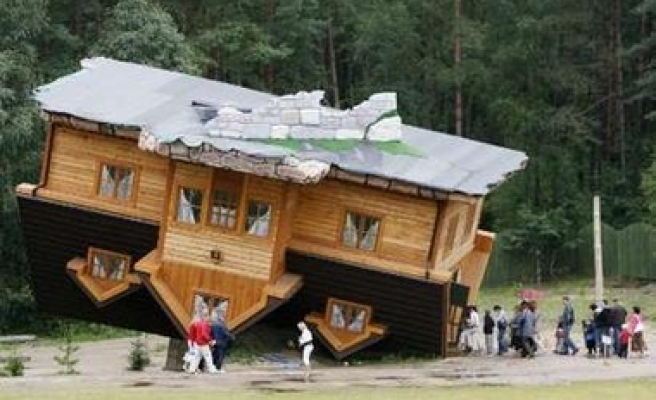 Many people visit the upside and down house in Poland