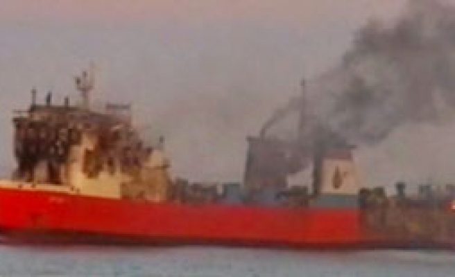 Russian rescue teams put out fire in Turkish ship