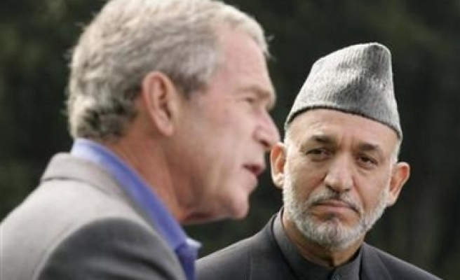 Bush, Karzai say they are aligned against Taliban