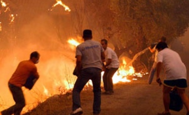 Greece declares emergency after fires kill 47