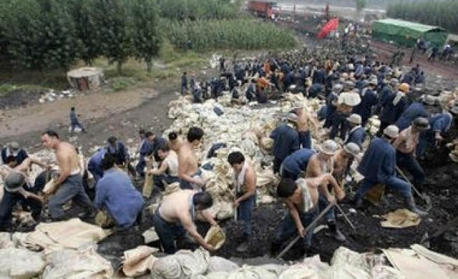 Trapped China miners dig out of collapse