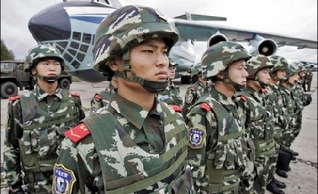 China to report military spending to UN