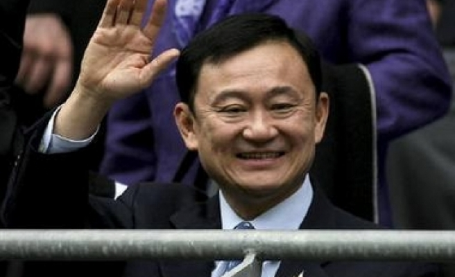 Second arrest warrant issued for Thaksin
