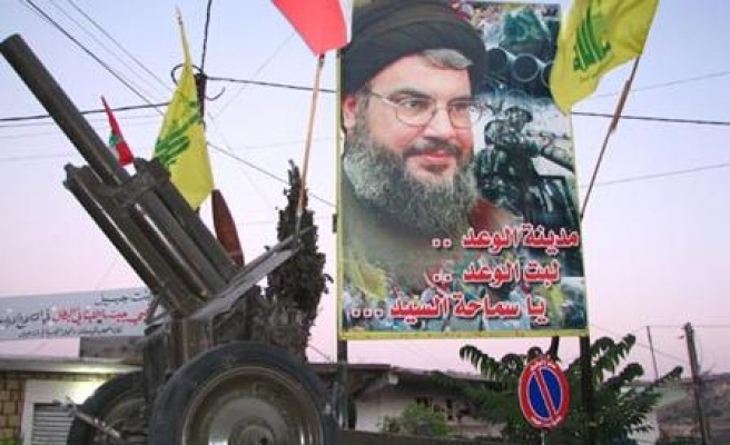 Hezbollah starts withdrawing gunmen from Beirut