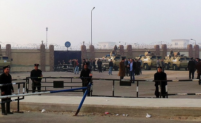 Egypt cancels jail terms of police who killed protesters