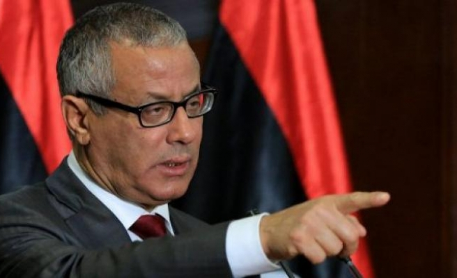 Former PM returns to Libya, vows to resume 'struggle'