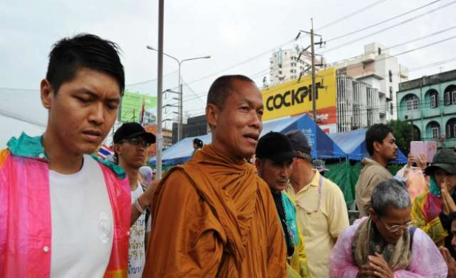 Thai Buddhist monk vows to fight on, protesters look to courts