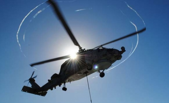 Missing Libyan army chopper 'came under fire'