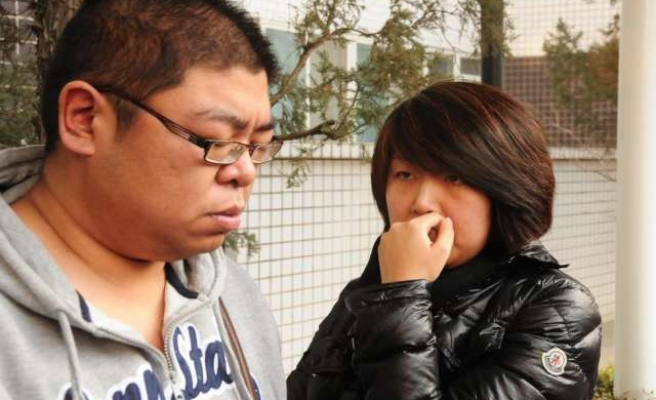 Relatives erupt with grief after Malaysia says plane crashed