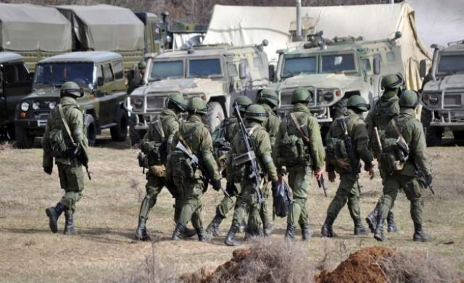 Russian forces take over border guard post in Crimea