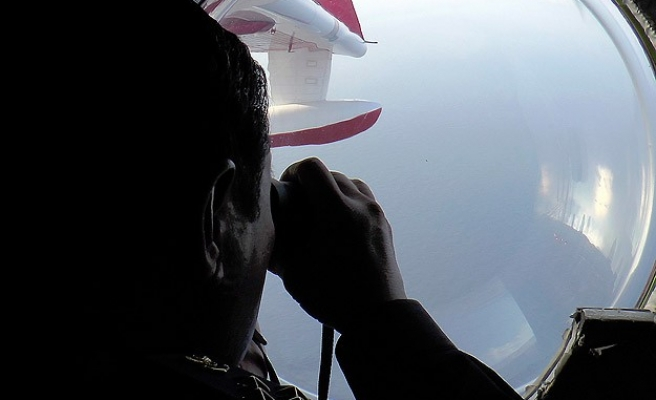Long search looms for Malaysia jet, families renew protests