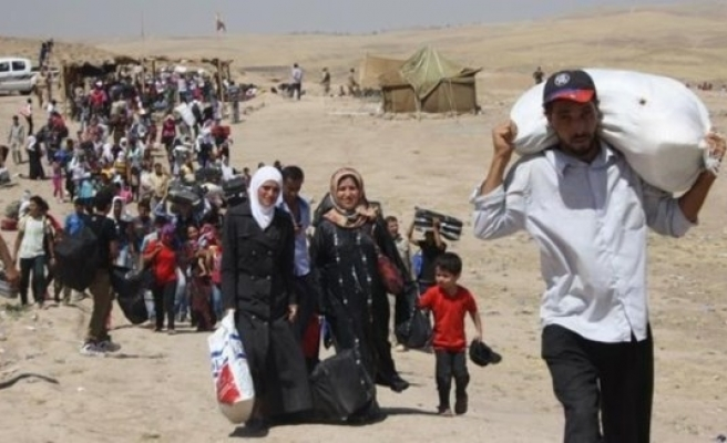 UN: Syrian refugees to reach 4.1 million by end of 2014