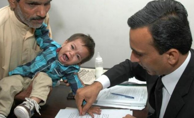 Pakistani baby taken into hiding after attempted murder charge