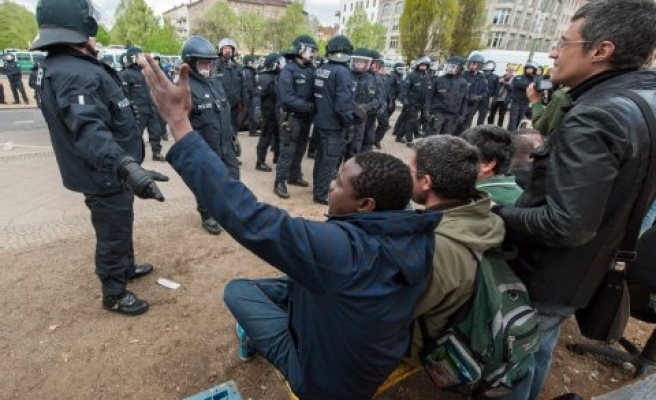 German police, protesters clash over refugee plans