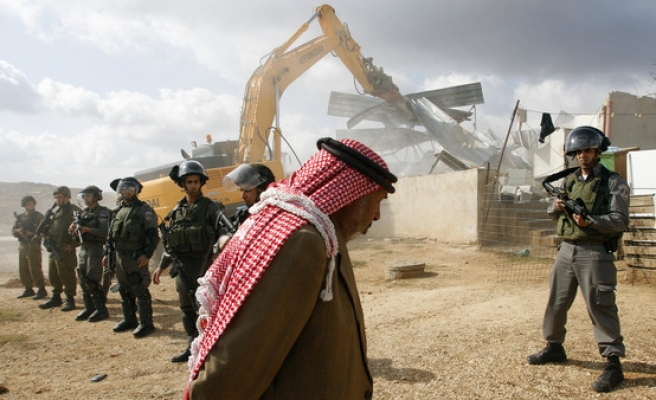 Israel destroys family homes of three Palestinians