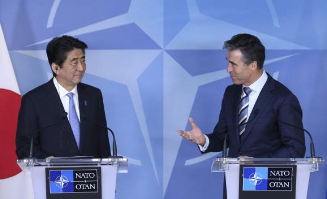 Japan, worried about China, strengthens ties with NATO
