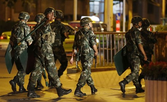 China sentences nine to death, detains 29 in E. Turkestan