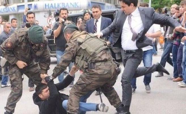 Turkish PM's aide fired for kicking protester
