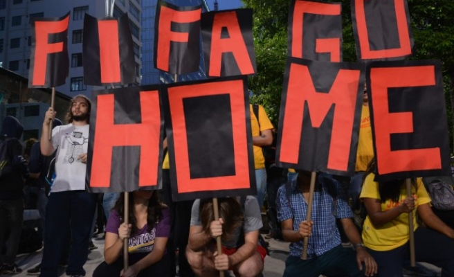 World Cup opponents march for Sao Paulo's homeless