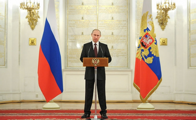 Putin says expects France to honour warships contract