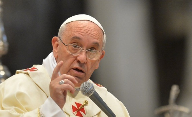 Pope calls for more market regulation, denies he is Marxist