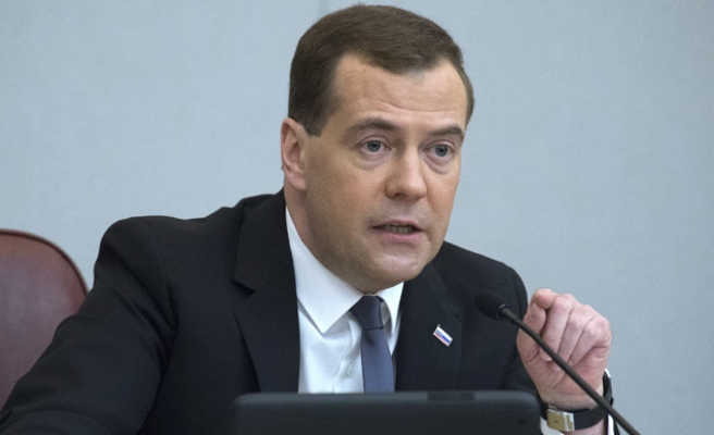 Medvedev vows to keep economy open, hails pivot to China