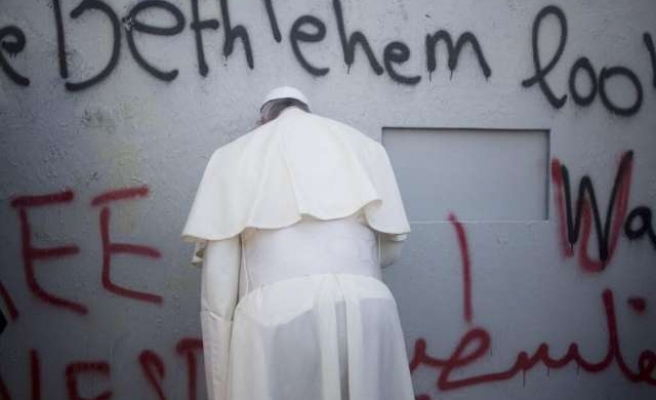 Pope prays at separation wall, calls for Middle East peace- UPDATED