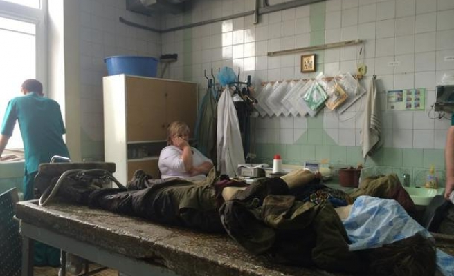 The reality of Ukraine's conflict in a Donetsk morgue