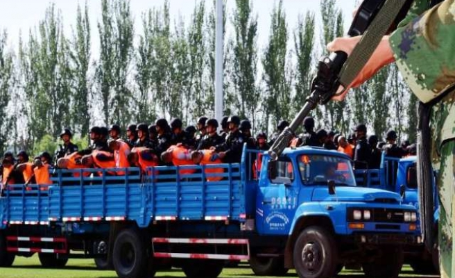 China targets Uighur imams in mass public sentencing