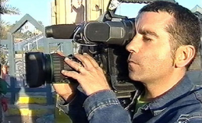 Spain to probe killing of cameraman by US shell in Iraq