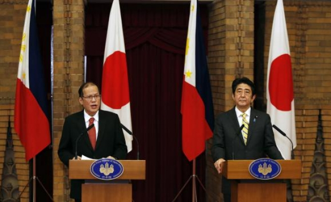 China accuses Philippines of stirring tensions by backing Japan