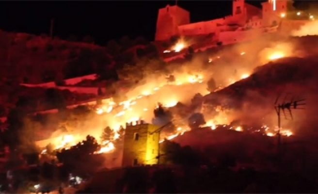 Spanish mayor charged with setting town on fire