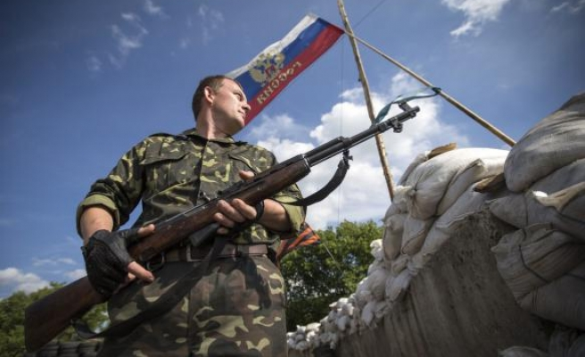 Ceasefire in east Ukraine frays, woman killed by shelling -UPDATED