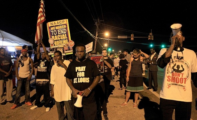 Protesters mark two weeks since police shooting in Ferguson