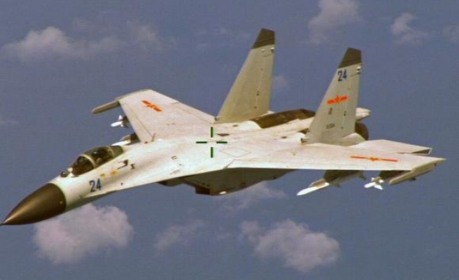Taiwan says Chinese military planes breached its airspace