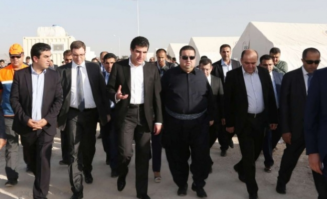 Iraqi Kurdish PM visits refugee camp built by Turkey