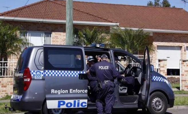 Australian police charge man after FBI-led raids