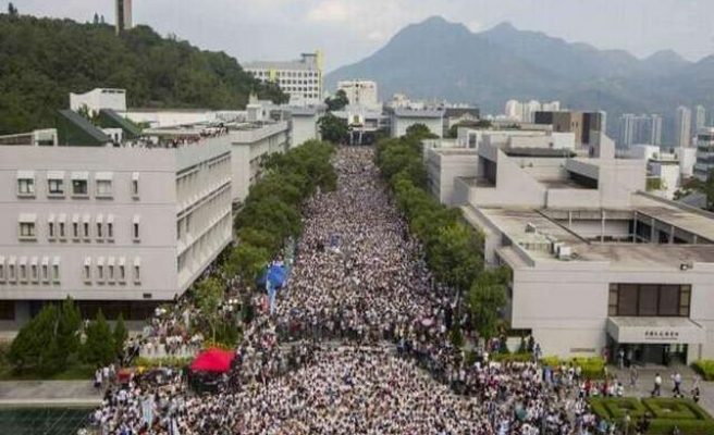 Hong Kong protesters mark uneasy National Day