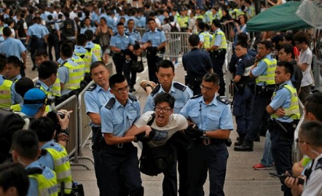 Three protesters arrested during overnight HK clashes