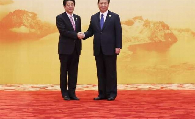 China hopes Japan can create favourable atmosphere for talks