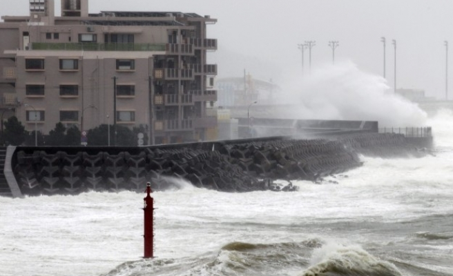 Typhoon brings heavy rain, wind to election-day Japan