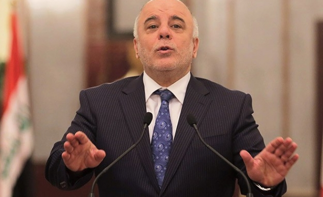 Iraqi PM warns falling oil price could hurt fight against ISIL