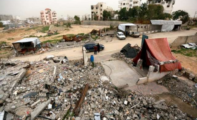 Living with the dead: Gazans seek shelter in graveyards